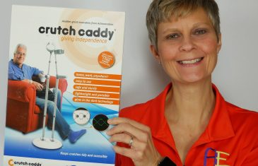 image Cindy holding Crutch Caddy box